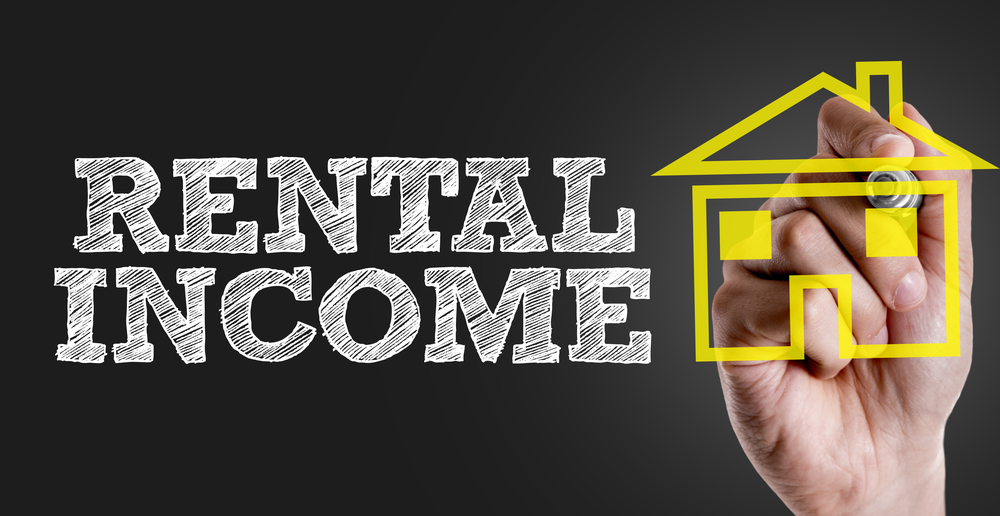 Rental Income Concept on Blackboard